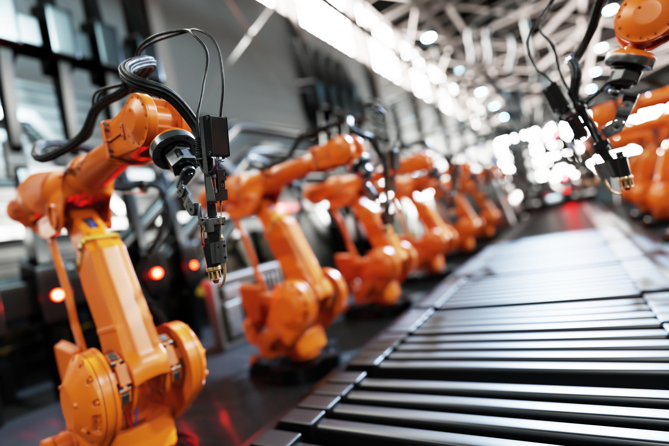 bigstock-Robotic-arms-along-assembly-li-353735198