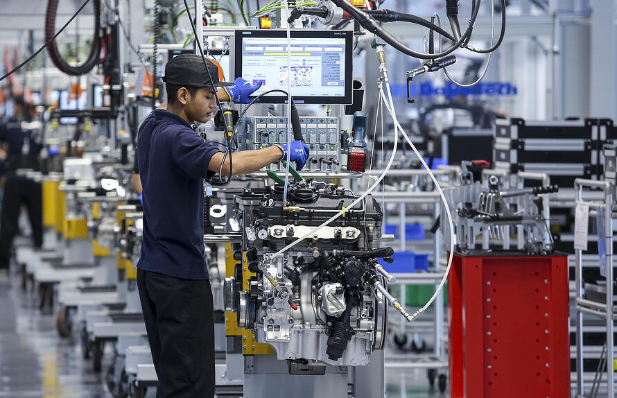 bigstock-Workers-At-Engine-Assembly-Pla-317936866