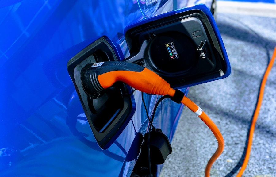 ev charging cord plugged into electric car